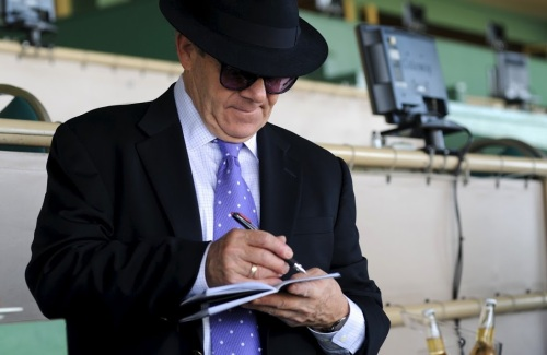 "Henry ""The Horse"" Weinstein makes notes on his next wager."