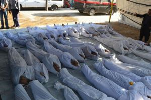 Syrian-activists-inspect-bodies-2202665