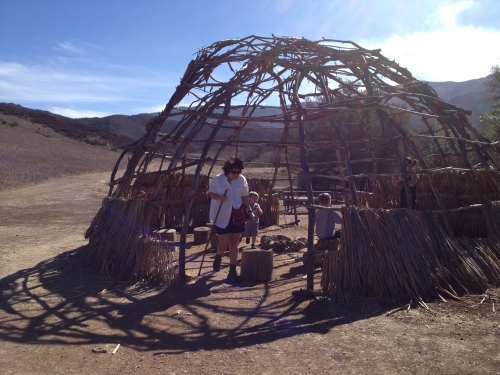 Victoria explores a traditional Chumash dwelling at the Satwiwa Native American Indian Cultural Center.