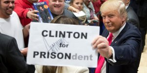 3-photos-of-donald-trump-holding-up-a-hillary-clinton-for-prison-sign